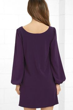 AS SEEN IN REDBOOK! You'll be primed and ready in the Perfect Situation Purple Long Sleeve Shift Dress when everything starts falling into place! This woven poly dress has a casual shift shape, accented by a rounded neckline and long sleeves with lightly puffed shoulders. Sleeves end with matching button tabs on the fitted wrist cuffs. Hidden side seam pockets.