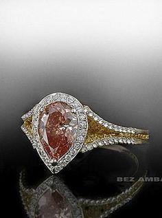 Pink Pear Shape Diamond framed in White Pave and yellow and white pave mounting.  Spectacular!