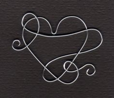 A creative heart made from one piece of wire - I love it!  Would also make a good pendant with sturdy wire.