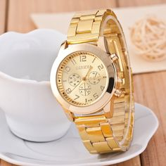 Aliexpress.com: Comprar Popular mujeres oro del acero inoxidable del reloj de ginebra mujer Rhinestone reloj de pulsera de cuarzo Ladies Luxury Brand relojes moda reloj de kilometraje del reloj fiable proveedores en GQ Fashion