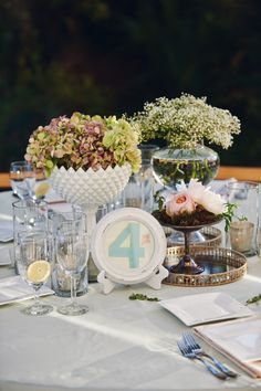 Eclectic array of vintage pieces to create a centerpiece // Photographer: Paul Johnson Photography / Wedding Planner/Coordinator: Carillon Weddings / Flowers & Decor: Myrtie Blue / Cake Baker: Kara Boo / Bride's Dress: Lazaro // see more: http://theeverylastdetail.com/intimate-blush-pink-vintage-chic-wedding/