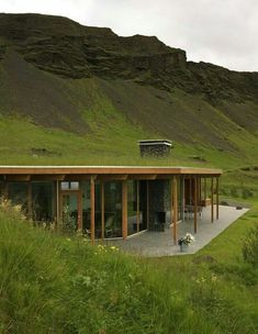 half-burried/underground house with green grass roof and preserved environment for a more eco-friendly human nature
