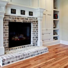 White washed brick fireplace with white mantle and white built in shelves....an option