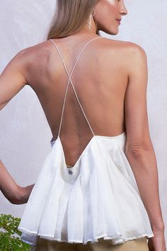 Business in the front, party in the back.  Let the detail of simple spaghetti straps and a low-cut back do the talking in this simple yet sophisticated cami.  Item: Elisa Top in White  #shopfashion #bohochic #vacationwear #resortwear #shopnewarrivals #whatshewore #fashionfinder #lotd #howtowear #fashion #worldfashion #golden #daytonightlook #summercollection #vacationwear #dailyoutfit #summerstyle #bohosummer #summeroutfit #ootd #bohoinspired #vacationstyle #daytonight #boholook… Sarong Skirt, Bali Fashion, Style Finder, Black Books, Vacation Style, Boho Look, Resort Wear, Matching Outfits, Spaghetti Straps