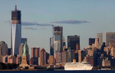 A cruise ship passes the World Trade Center in New York and the Statue of Liberty, left, on Monday, Sept. 10, 2012 in this photo taken from Bayonne, N.J.  The tallest tower is 1 World Trade Center, now up to 104 floors, and in the center is 4 World Trade Center, also under construction. The tallest tower, Freedom Tower, will be 1,776 feet tall, including its spire, a reference to the year of American independence. Photo: Mark Lennihan / Associated Press