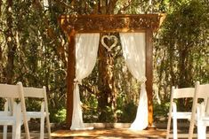 Outdoor wooden arch with curtains