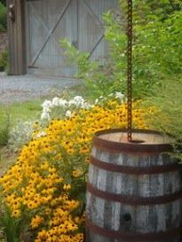 Recycled barrels for gutter downspouts