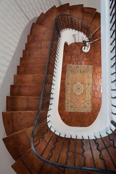 Mediterranean staircase by Thomas Thaddeus Truett Architect - Interior Mexican Pavers (Adoquines del Interior Mexicanos)    Saltillo tiles, or Mexican pavers, are named for the Mexican city Saltillo. Coahuila pavers are made of terra-cotta and come in a multitude of shapes, sizes and colors.
