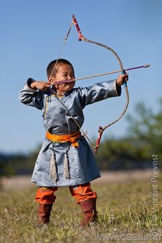 Military uniform: gray-blue tied with gold sash, matching leggings, boots. Archer in Mongolia