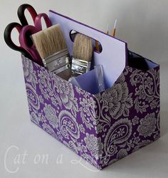 Soda or beer holder painted and papered, now handy tote.