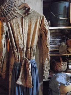 Primitive dress with homespun in cupboard