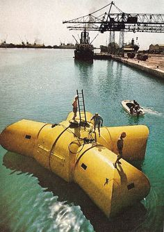 Jacques Cousteau's Underwater Village (Conshelf II): Preparations for a housing structure.