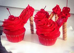 Red velvet ruby slipper cupcakes and a rubber ducky cupcake
