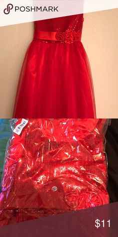 Red Valentine's Day dress I got this dress online for my girls, I opened one and it did not fit them so I left this one in the package. I would say it's actually about a size 5, maybe a size 6, it was marked as a size 7 but no way it's a 7. Waist measures 11 inches across, and its 27 inches long from strap to bottom of dress. Head opening is about 18 inches around. Dresses Formal