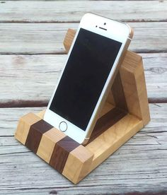 Walnut and Tiger Maple iPhone Stand by MinnesotaWoodcraft on Etsy https://www.etsy.com/listing/254191374/walnut-and-tiger-maple-iphone-stand