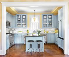 Classic Cottage Painted in traditional cottage blues and yellows, this space-smart kitchen has a great personality. Adding a small island allows for seating and gives the cook a designated work zone.