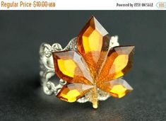 HALLOWEEN SALE Maple Leaf Ring. Bright Amber Ring. Autumn Ring. Nature Ring. Leaf Jewelry. Adjustable Ring. Handmade Ring. Handmade Jewelry. by StumblingOnSainthood from Stumbling On Sainthood. Find it now at http://ift.tt/2e7SzHt!