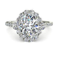 Bague de fiançailles solitaire diamant Alexandrina 1,30 carats or blanc  Somptueuse bague de fiançailles, Alexandrina est faite pour le plaisir du regard et le plaisir d'être portée. Sa pierre centrale qui est ovale est entre 0,30 carats et 1 carat selon votre choix. Autour du diamant central de cette bague, il y a 2 diamants qui la rehaussent et 12 diamants ronds. Cette belle bague de fiançailles diamant que nous fabriquons dans nos ateliers est montée sur de l'or blanc, jaune ou rose 18…