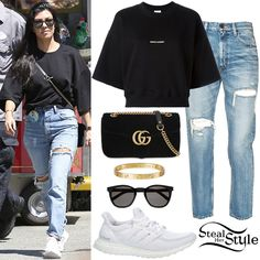 Kourtney Kardashian celebrated her 38th birthday at Disneyland in Anaheim wearing a Saint Laurent Cropped Logo Sweatshirt ($490.00), Moussy Bowie Skinny Jeans ($305.00), a Gucci GG Marmont Velvet Bag ($1,590.00 – wrong color), Saint Laurent Classic 28 Sunglasses ($365.00), two Cartier Love Yellow Gold Bracelets ($6,300.00) and Adidas Ultra Boost Shoes ($179.99).