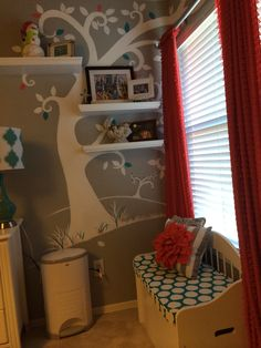 Little girl room complete with tree mural, window seat in salmon , turquoise, White and Gray . Adorable !