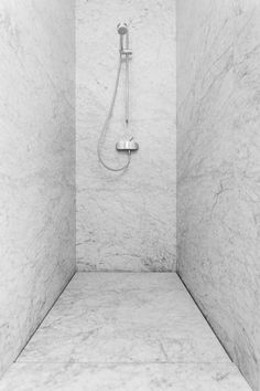 Carrara slab shower. Simple and beautiful Design credit: VIl Granito Photo Credit: Tineke de Vos #UniqueBaths