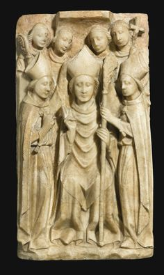 ENGLISH, NOTTINGHAM, 15TH CENTURY RELIEF WITH THE CONSECRATION OF ST THOMAS BECKET AS ARCHBISHOP OF CANTERBURY partially polychromed alabaster, on a modern metal stand relief: 48.5 by 26cm.