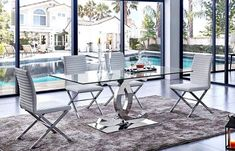 Not only making a dining room looks modern, but a glass dining table can also make the room looks elegant. These modern glass dining table design are great! Luxury Dining Tables, Modern Dining Room Tables, Dining Room Sets, Dining Table Chairs, Dining Furniture, Furniture Stores, Furniture Design, Glass Dining Table Designs, Glass Dining Table Set