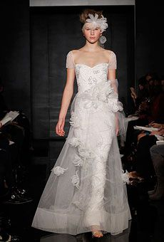 """Reem Acra This cap-sleeve column gown with detachable tulle illusion skirt is a perfect play on the two-in-one trend. The silhouette is full yet ever-so-light, like a thin layer of crema. And Acra's signature ethereal beadwork throughout this number, in fact, does send us """"over the moon.""""    Over the Moon, $7,000 (dress); #4636"""