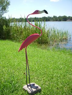 PipeBirds - All Rights Reserved This majestic flamingo stands about 30 high. A beautiful addition to your garden decor that sways in the wind. Mounting block is not included. Feet are pre-drilled and mounting screws are included. Please take a moment and check out our other birds. If you