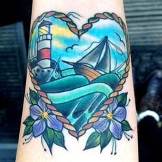 tattoo old school / traditional nautic ink - lighthouse with sailboat