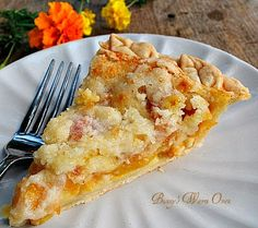 Incredible Peaches and Cream Pie...The peaches are nestled in a sour cream layer while the topping adds a nice crunch to the pie.  The peach flavor is up front and wonderful !