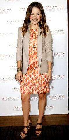 APRIL 30, 2011 Sophia Bush WHAT SHE WORE Bush attended an Ann Taylor lunch at Chateau Marmont in the label's sunburst sheath and bronze cuff paired with a khaki blazer and leather heels.