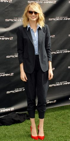 Emma Stone wearing Boy by Band of Outsiders blazer, shirt and cuffed pants. We love her red Kurt Geiger heels, too.