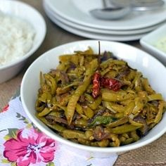 A spicy & delicious Ivy gourd (dondakaya/ tindora) curry -- simple South Indian accompaniment.