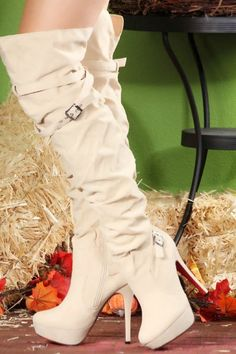 I don't usually like white boots, but these are gorgeous!!!