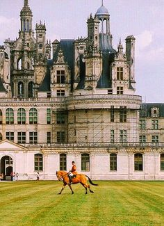Chateau de Chambord, France  Can't get over the size.  I'll bet you could get really lost in there!