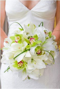For the ladies in the bridal party, I would like a bouquet which looks like this one with red oriental lilies and white orchids. The bouquet for the bouquet toss would be a small version. Bouquet Bride, Orchid Bouquet, Flower Bouquet Wedding, Lily Bouquet, Bouquet Flowers, Green Wedding, Floral Wedding, Wedding Colours, Green Orchid
