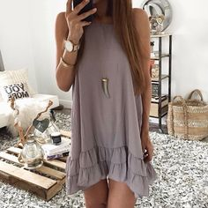 Sleeveless ruffle hem Bohemia dress in lightweight chiffon with the 'you can never wear too much jewelry' gypsy philosophy long necklace, arm cuff, bangles, & rings