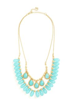 Ritzy Radiance Necklace. You exude a cool glow when you top a formal ensemble with this two-tiered statement necklace. #blue #modcloth
