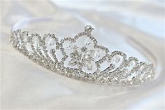 CAD$40.00 - A sparkly rhinestone crystal bridal tiara. It makes an elegant bridal halo, wreath or crown, with a silver wire band for styling convenience.  beautiful bridal Hair pieces, for amazing prices check out our website www.karmabridal.com
