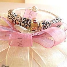 Beautiful feminine PANDORA bracelet design. We love it!