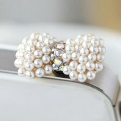 $1.28 Fashion Sweet Style Pearl Embellished Bowknot Cellphone Dustproof Plug