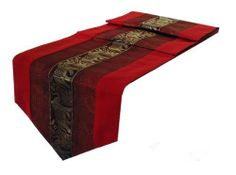 "Table Runner Thai Silk & Cotton - Red Color by Siamfabrics. $26.99. Concealed Stitching. The underside is in a plain Black color. Made in Northern Thailand. Beautiful Center Elephant Design. Stunning Table Runner Thai Silk and Cotton Mix. Length 79""  Width 13.5"". All these table runners are made for us by local people here in Chiang mai northern Thailand, famous for its Elephants and Silk fabrics, a mix of Silk and Cotton are used, the cotton will give it durability and weight w..."