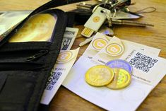 Bitcoin paper, coin and USB wallets.