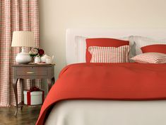 Bedroom decorated in red bedspread and curtains in Christmas style - stock photo Bedroom Red, Bedroom Colors, Modern Bedroom Decor, Bedroom Furniture, Red Bedspread, Lowe's Home Improvement Store, Bedside Drawers, Unique Colors, Trends