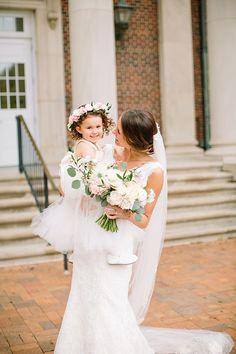 Formal Spring Wedding in Texas, Bride with Flower Girl | Brides.com