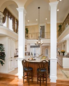 Two story kitchen. Not crazy about the white, but love the idea of a 2 story kitchen being in the middle of the home.