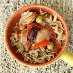 Tender chicken, vegetables and briny olives cooked in a tomatoey, white wine broth.