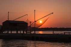 Sunset on fishing sheds in Cesenatico by margheorlandi