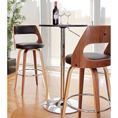 Step into the future of kitchen design with the modern appeal of the Cecina Barstool. A curved wood frame, chrome footrest and swivel seat are smartly juxtaposed by a traditional high cushioned back and seat.